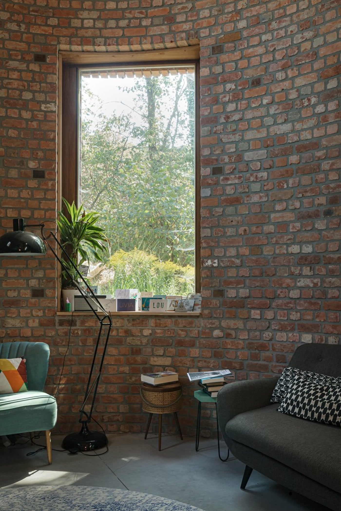 Close up view of lounge room with recycled brick wall