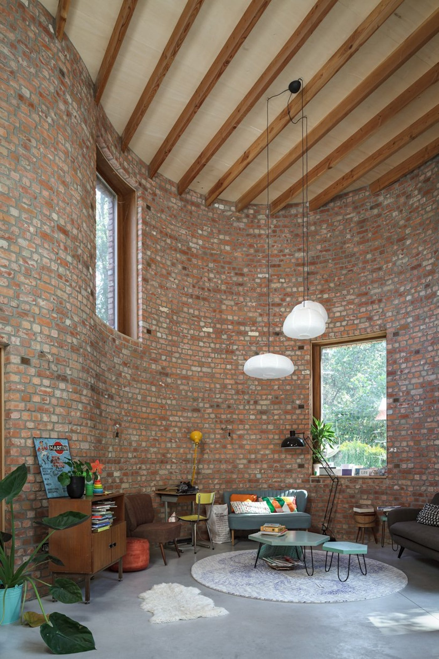Recycled brick interior with plywood ceiling