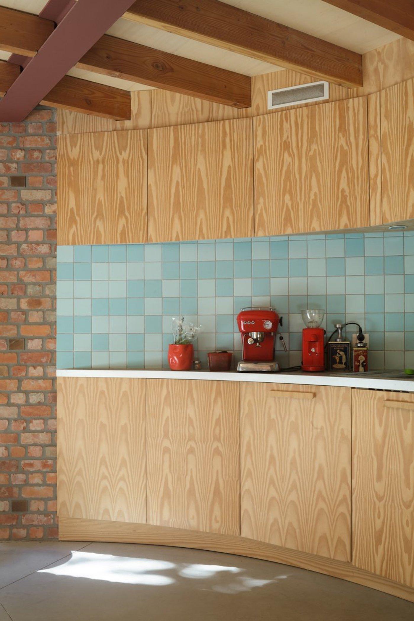 Curved timber kitchen with tile splash back