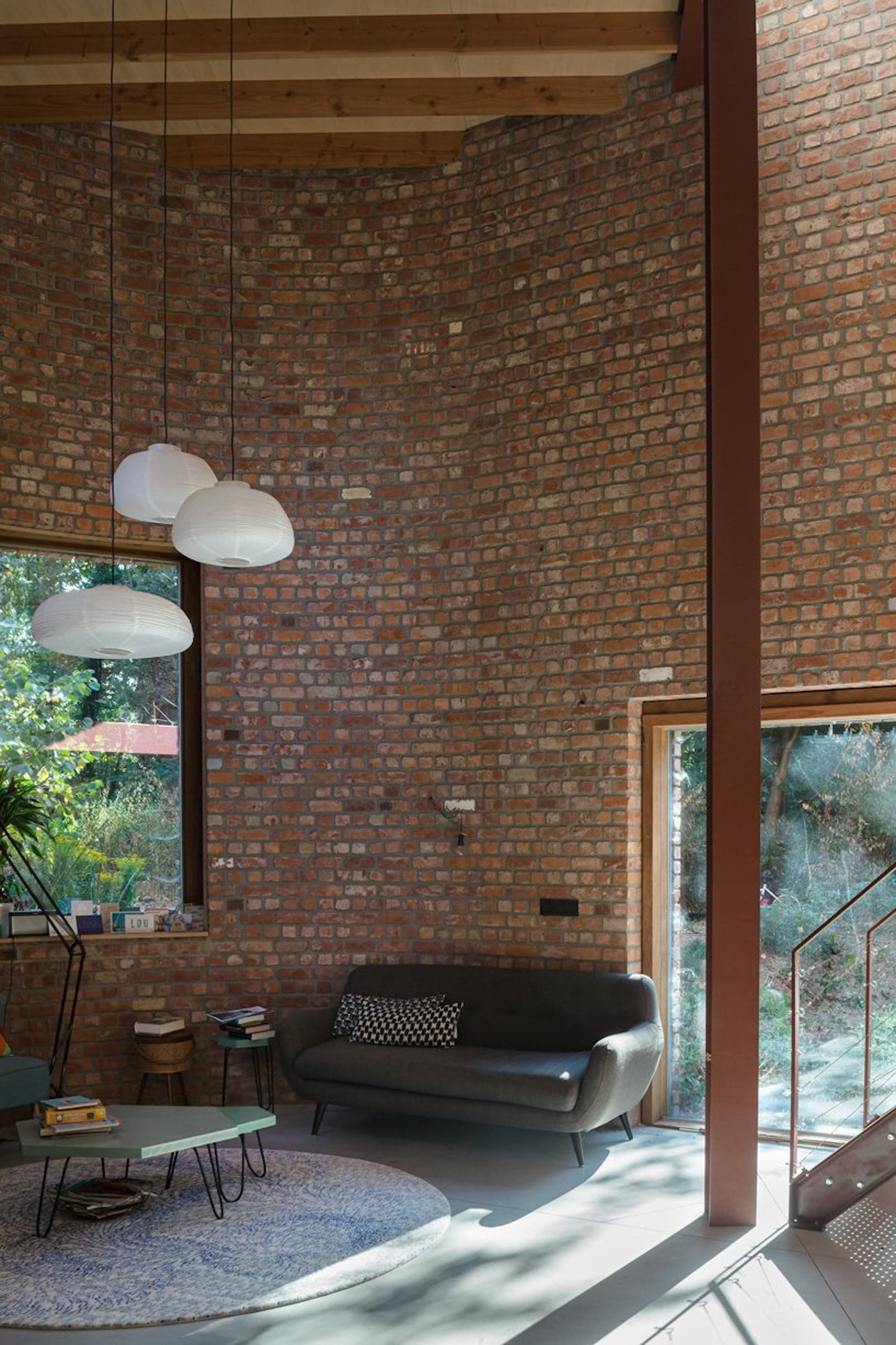 Interior view of lounge room with recycled bricks behind