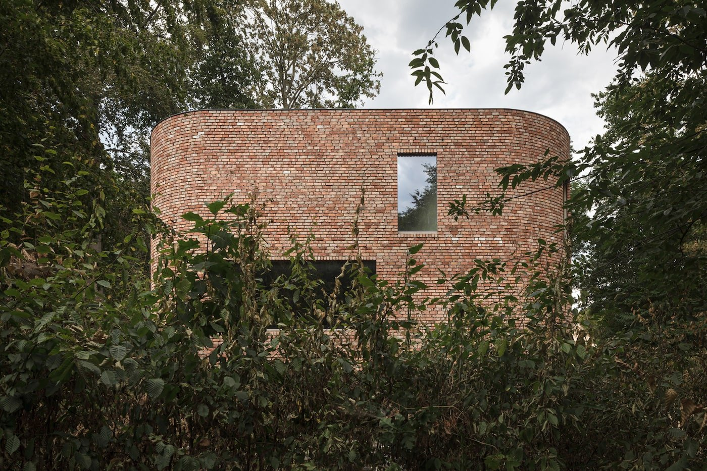 Looking through garden towards recycled brick house
