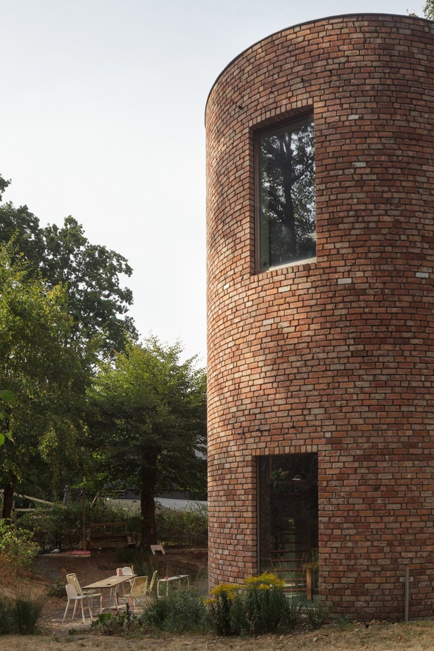 Courtyard next to recycled brick home