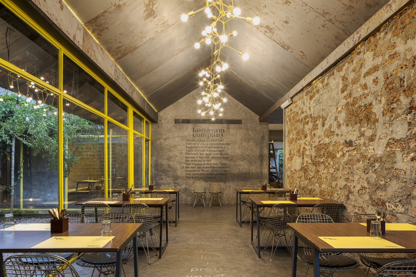 Restaurant interior salvaged bricks recycled metal sheets on ceiling