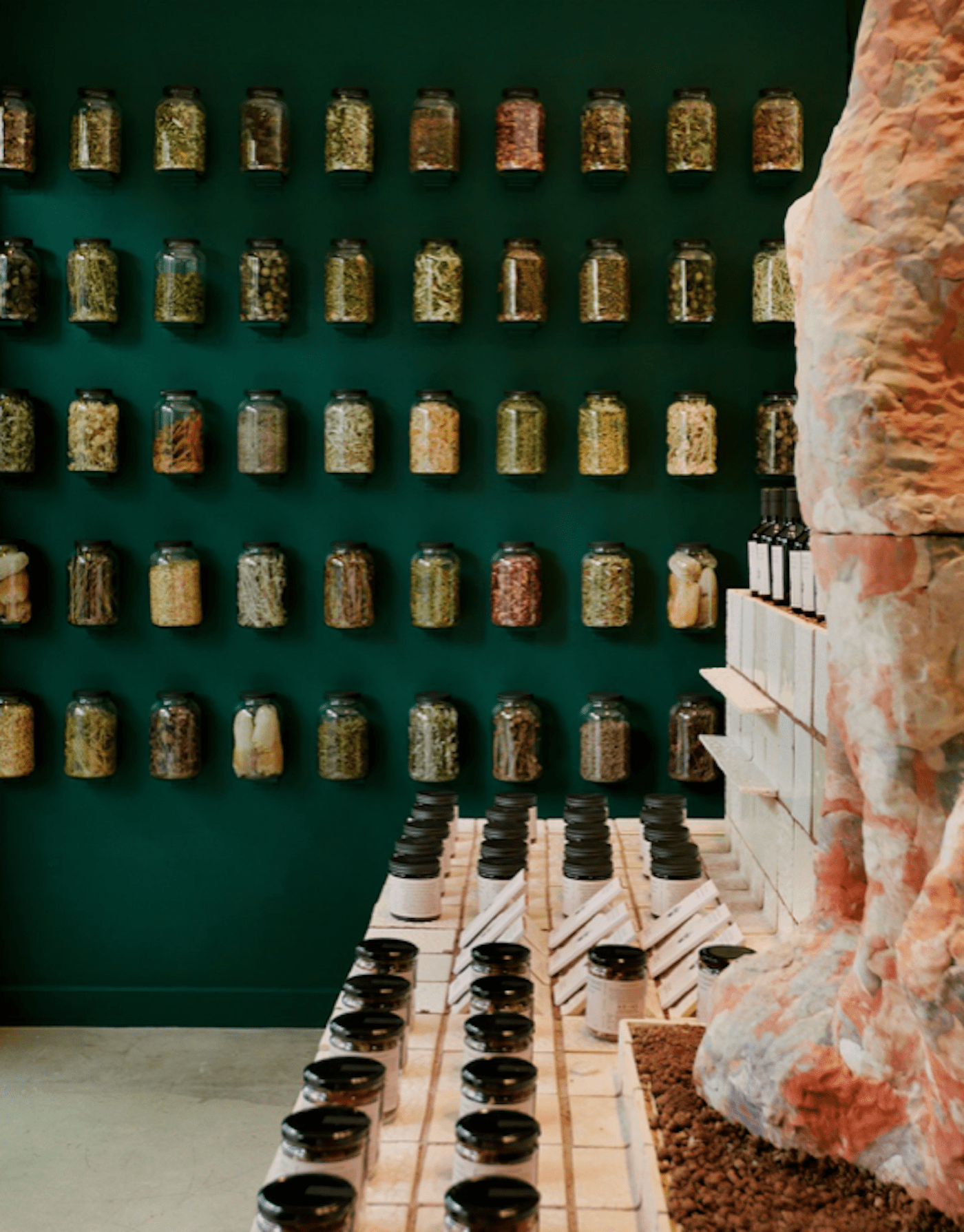 Glass bottles on green wall