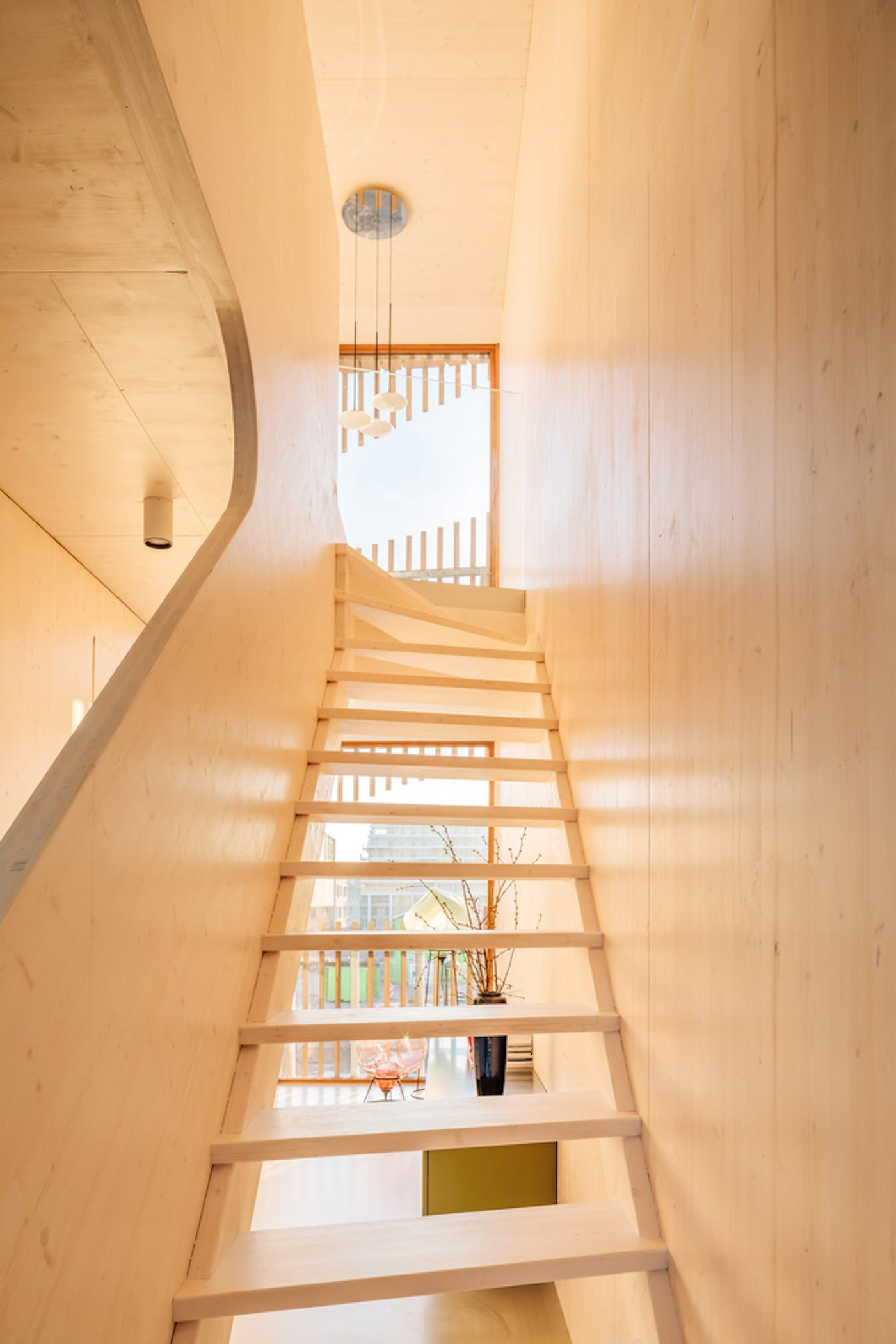 Timber stairs with open treds and timber stair well