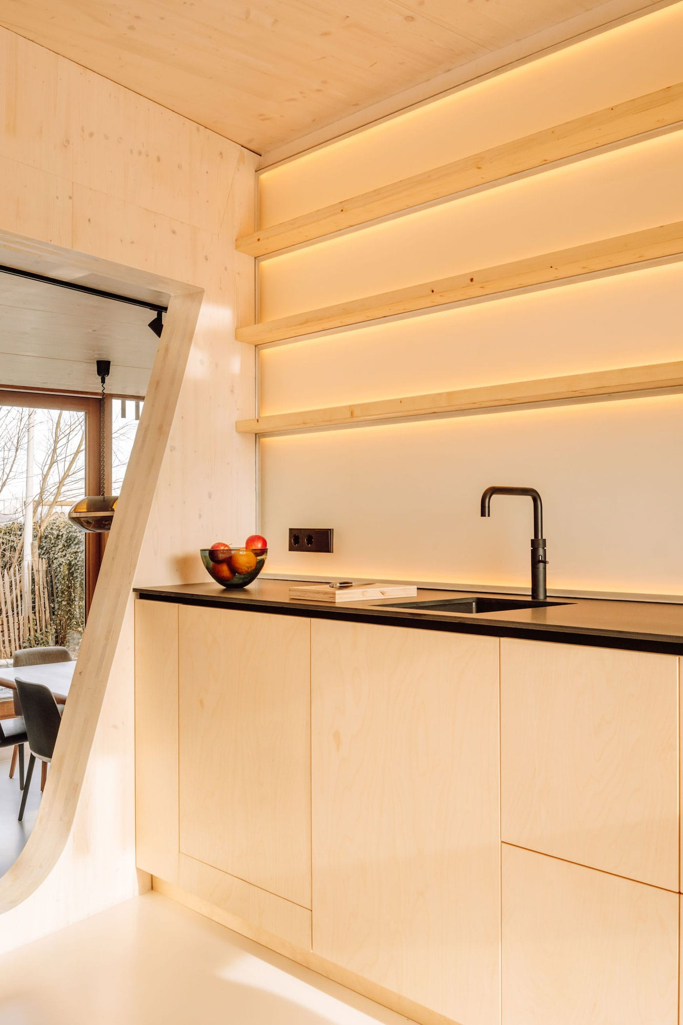 Timber kitchen with LED lighting under shelves