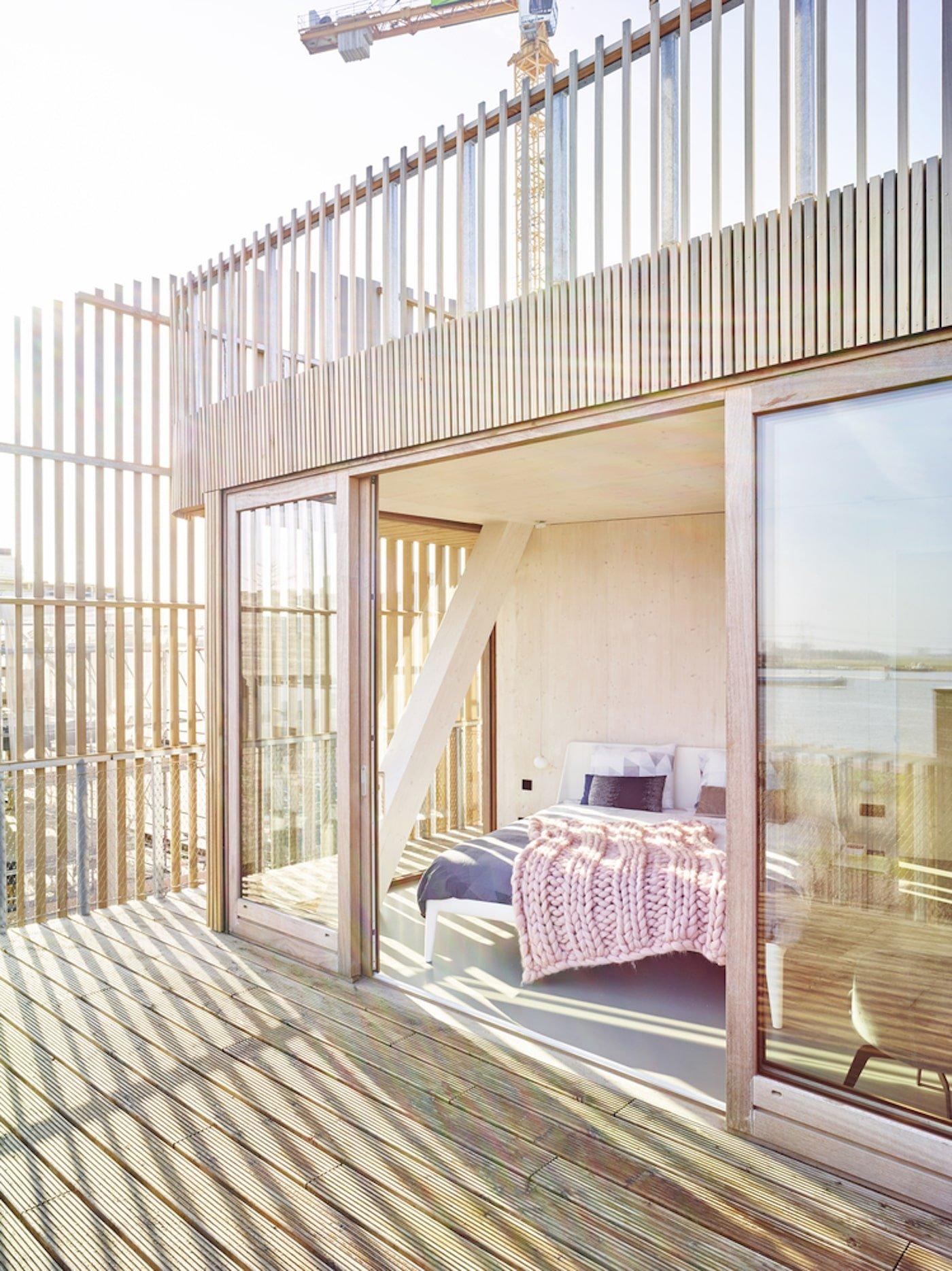 Timber balcony looking into bedroom
