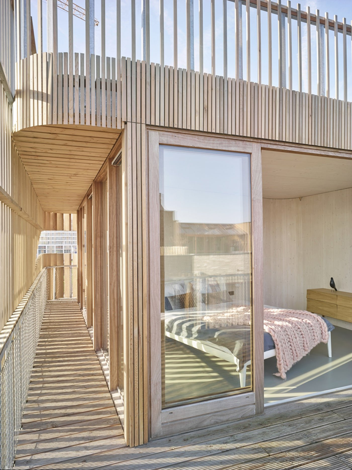 Timber clad exterior looking into bedroom