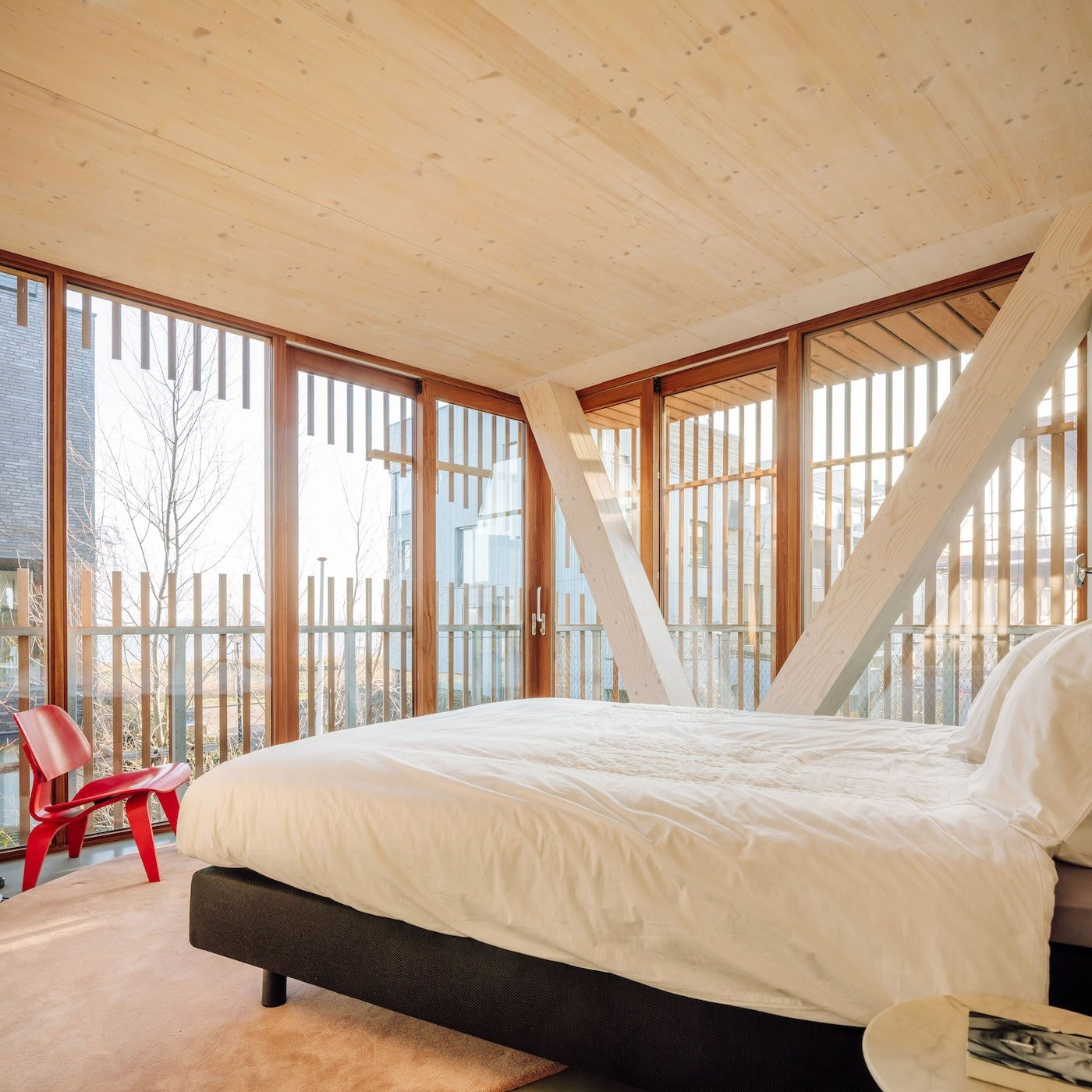 Cross laminated timber structural beams in bedroom