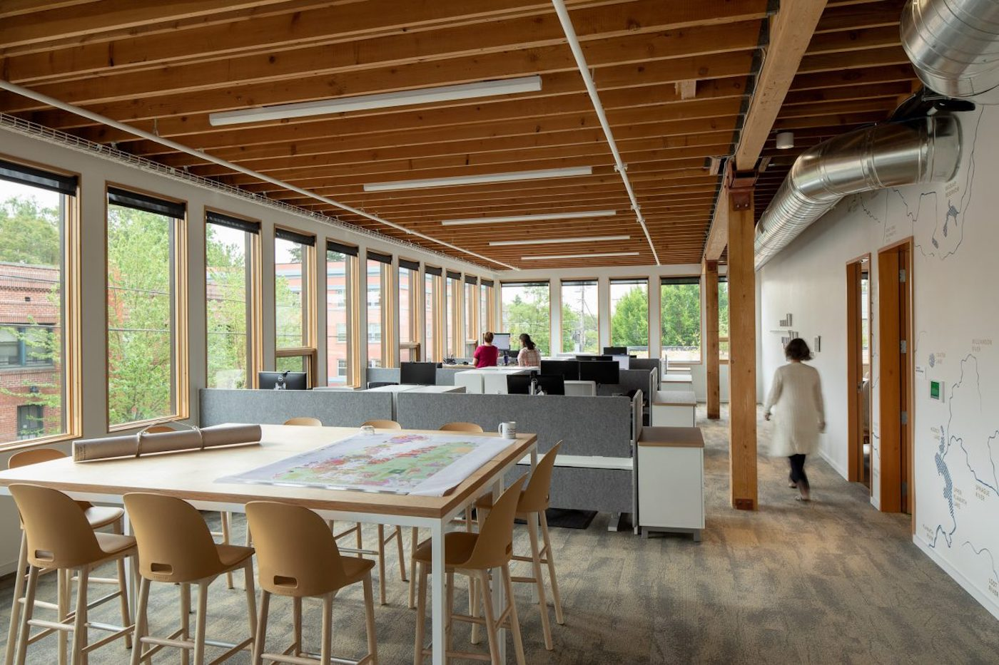 Open plan work area with exposed timber beams