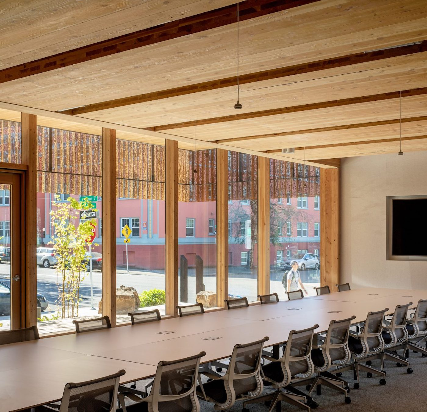 Large timber meeting table with timber ceiling