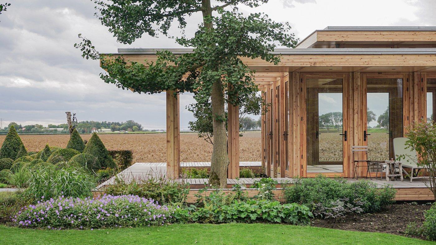 Timber deck overlooking farmland and garden