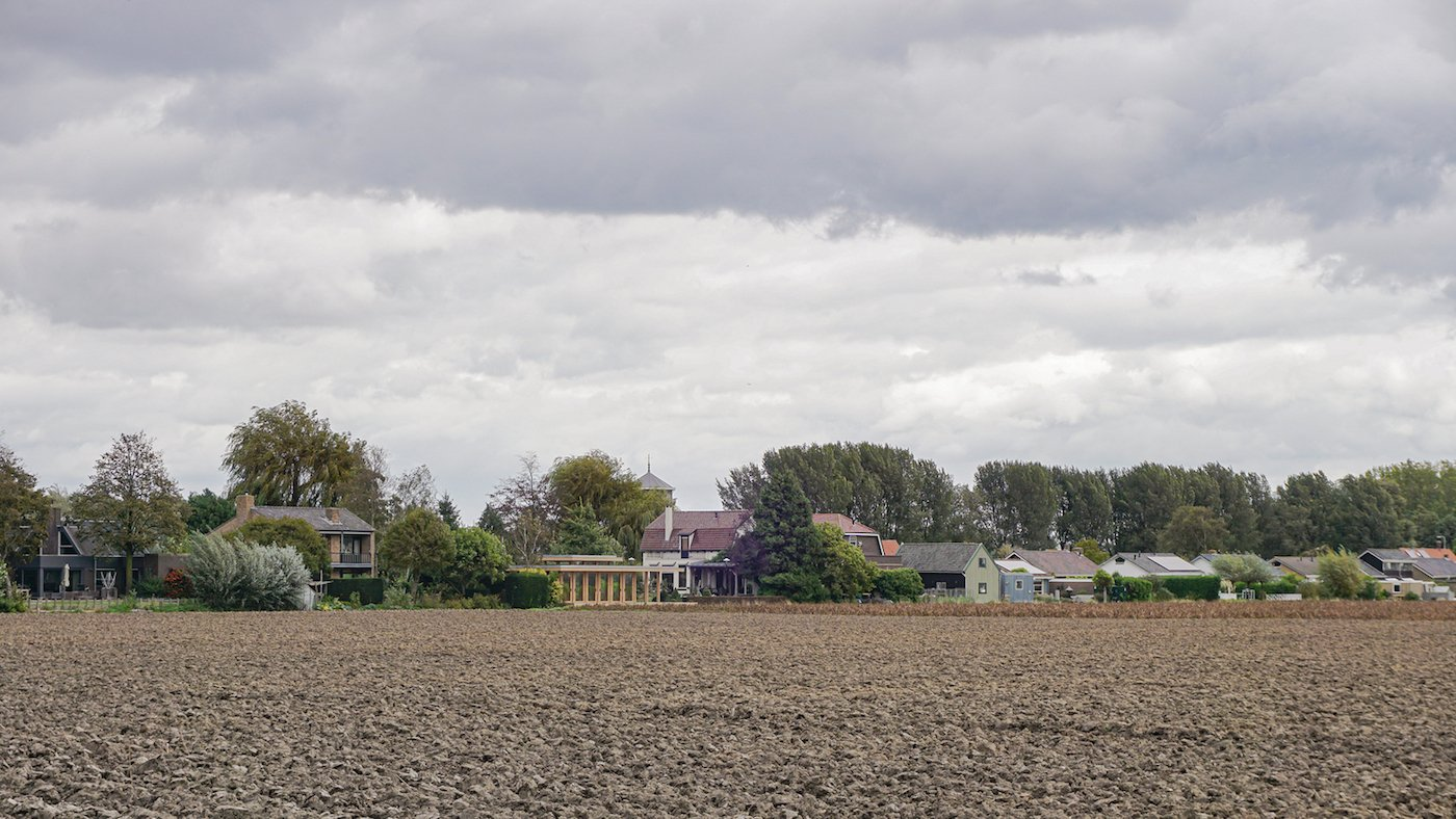 View to the home across dry farmland