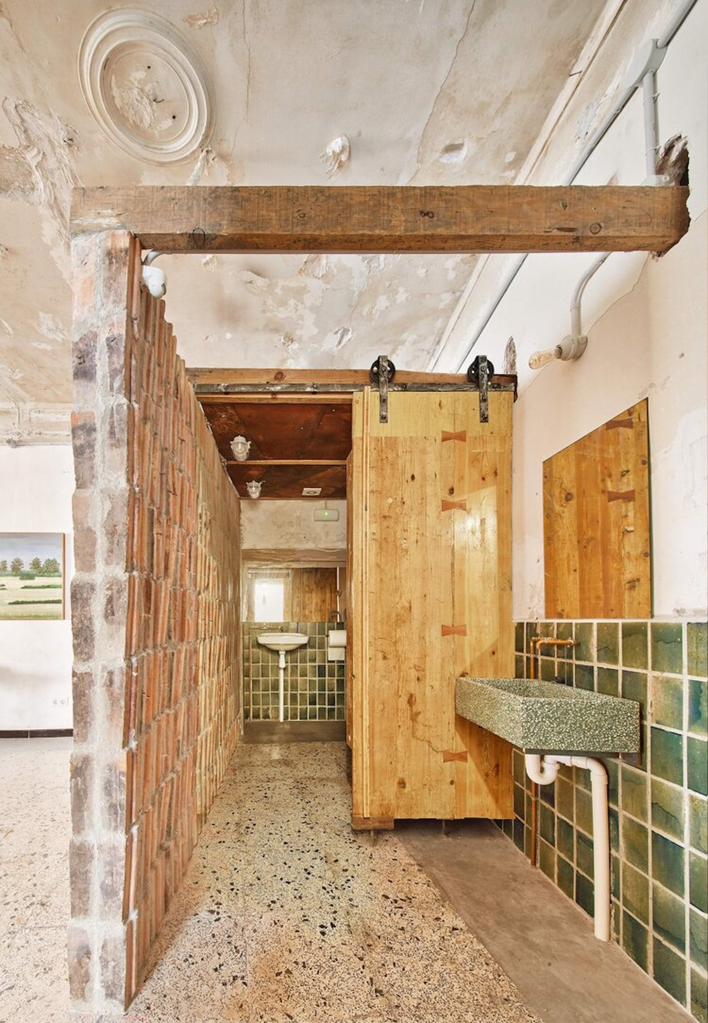 Bathroom with recycled brick walls and timber