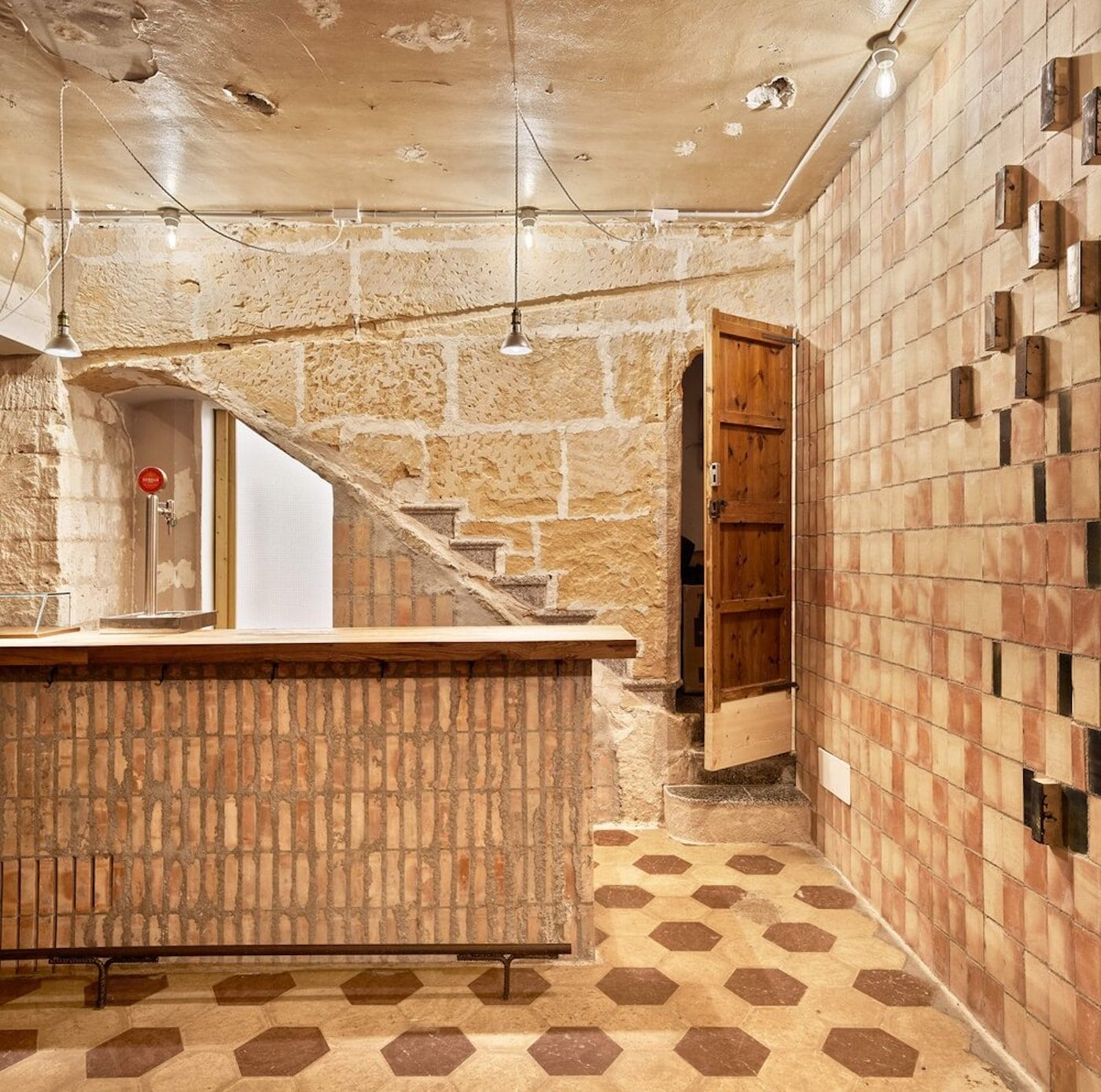 Sandstone and vertical bricks in adaptive reuse cafe