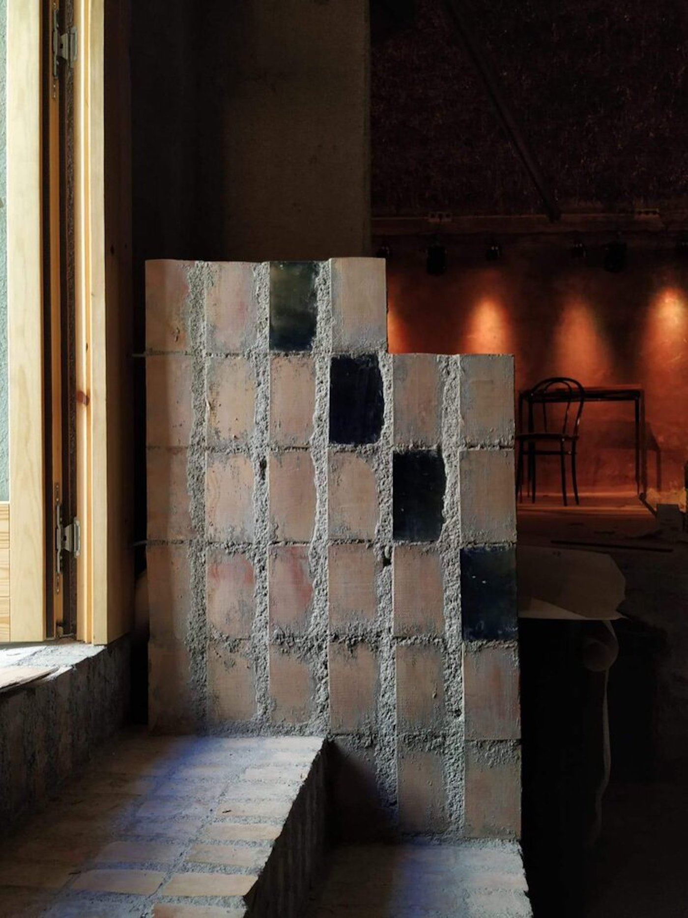 Mixed recycled bricks on wall and brick steps