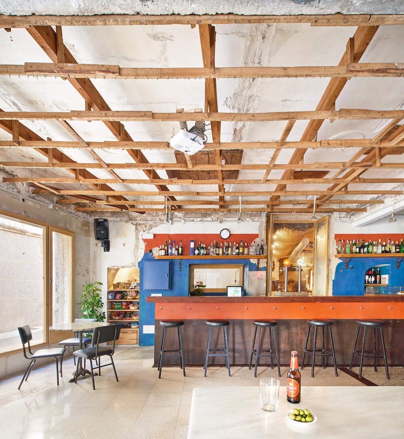 Exposed timber ceiling looking towards timber bar