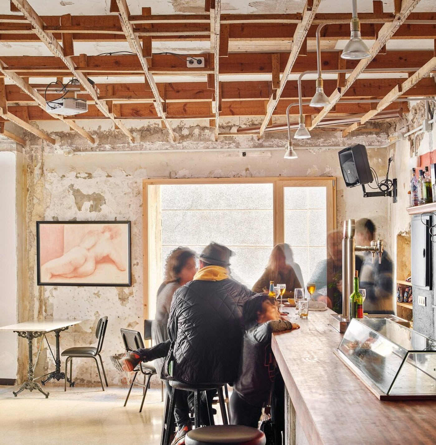 Exposed timber ceiling in cafe