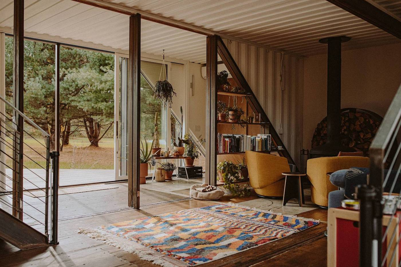 View towards wood fireplace in upcycled shipping container house