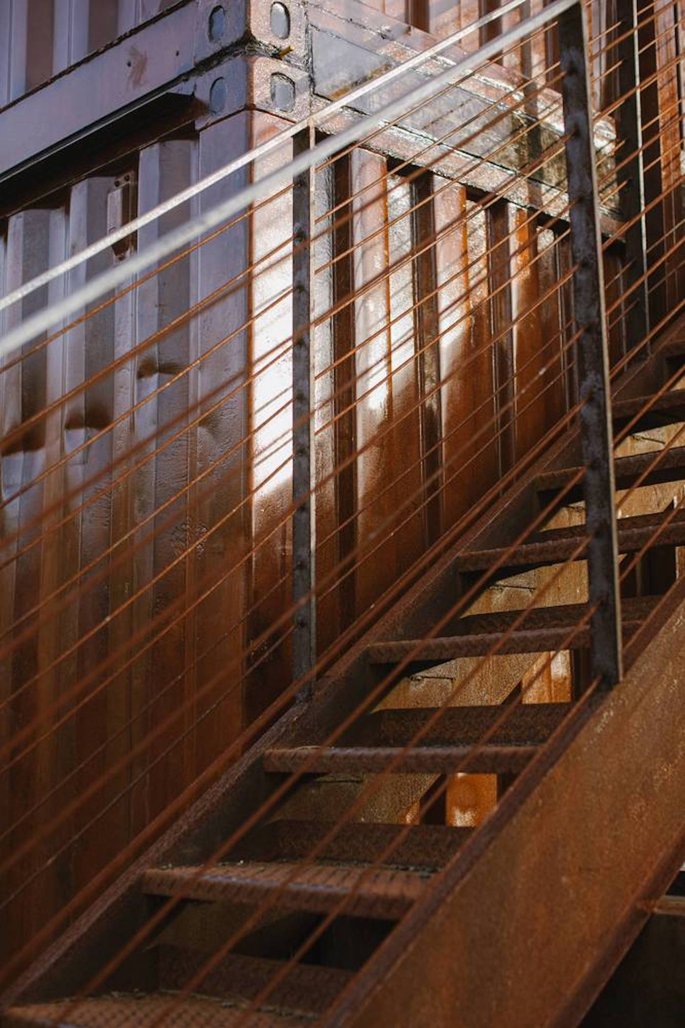 Corten steel stairs in upcycled shipping container home