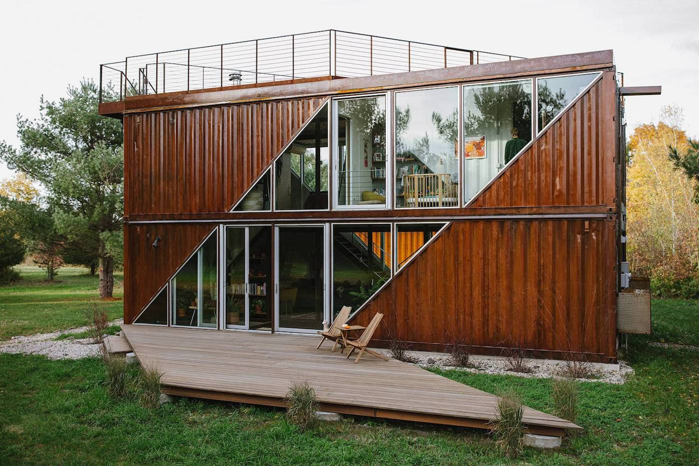 Shipping container home clad in corten steel