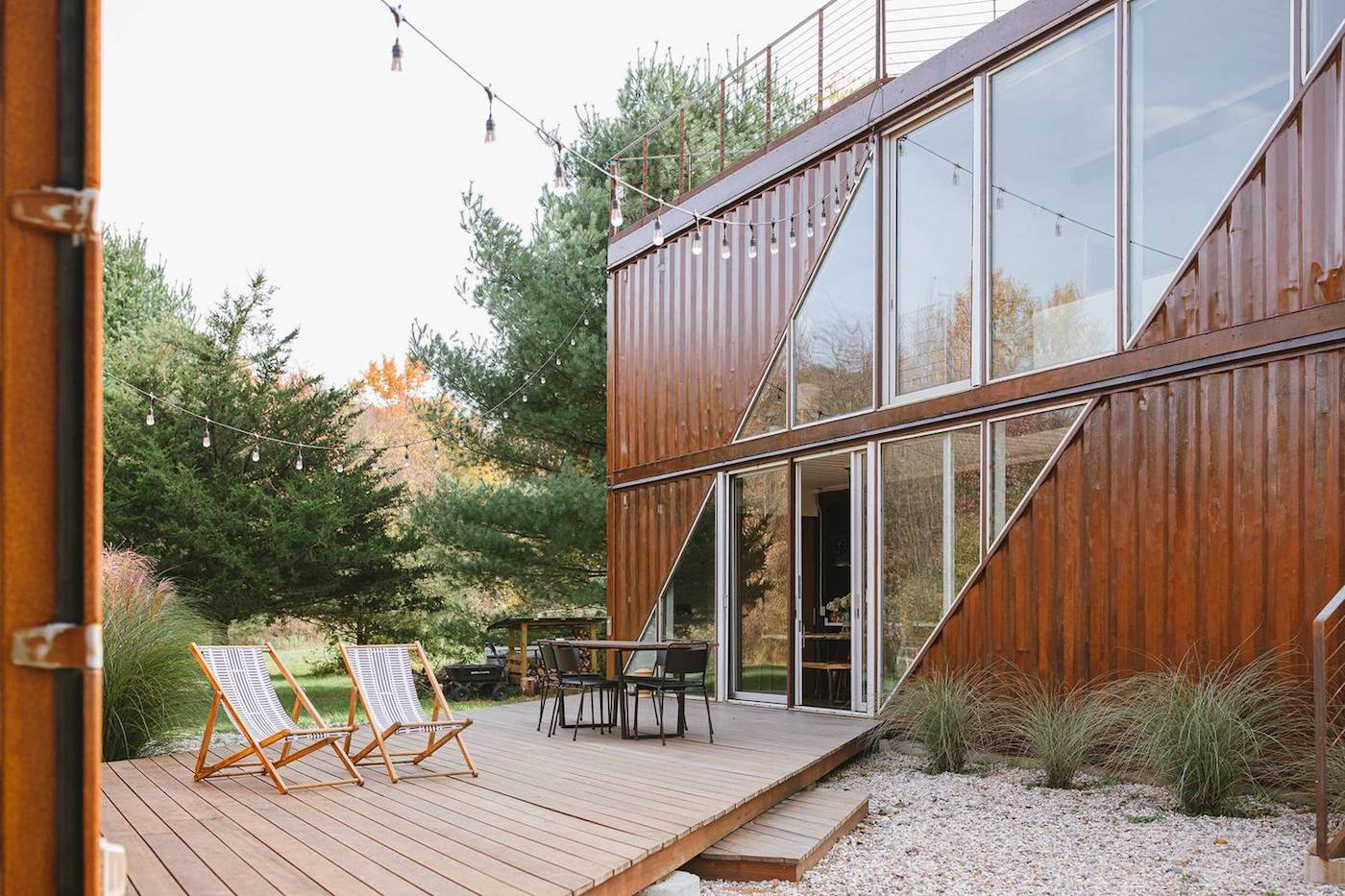 Shipping container home with timber deck