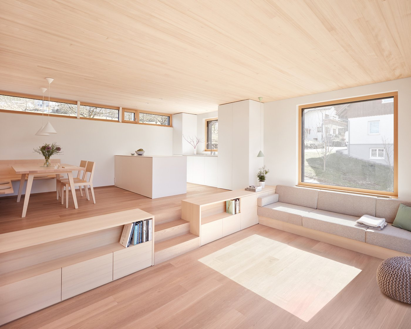 Lounge room and kitchen with timber floor