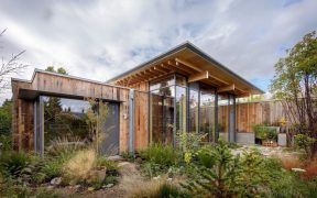 Timber clad home with native garden landscaping