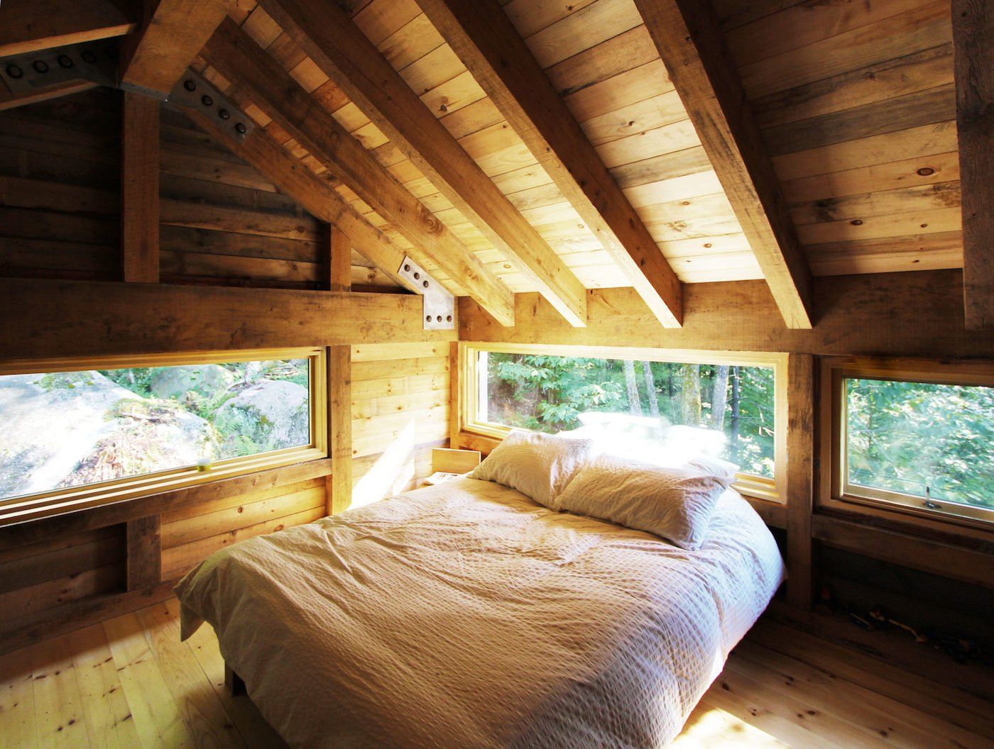 Loft bedroom with timber floor and ceiling
