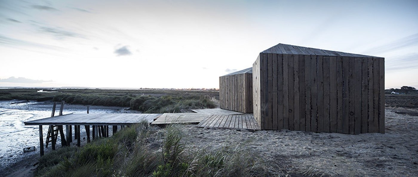 Recycled timber cabins next to a wharf