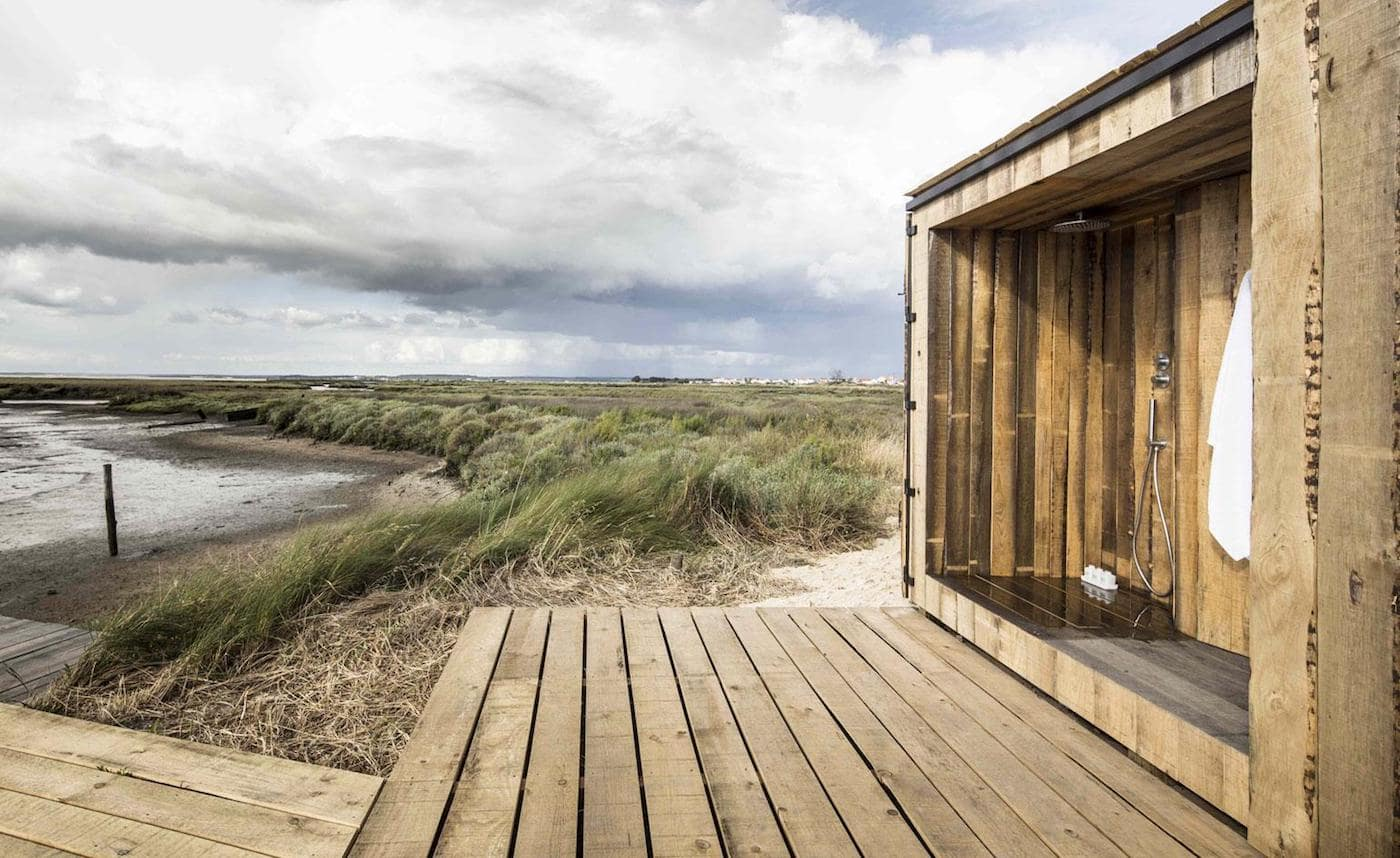 View across timber deck and timber bathroom