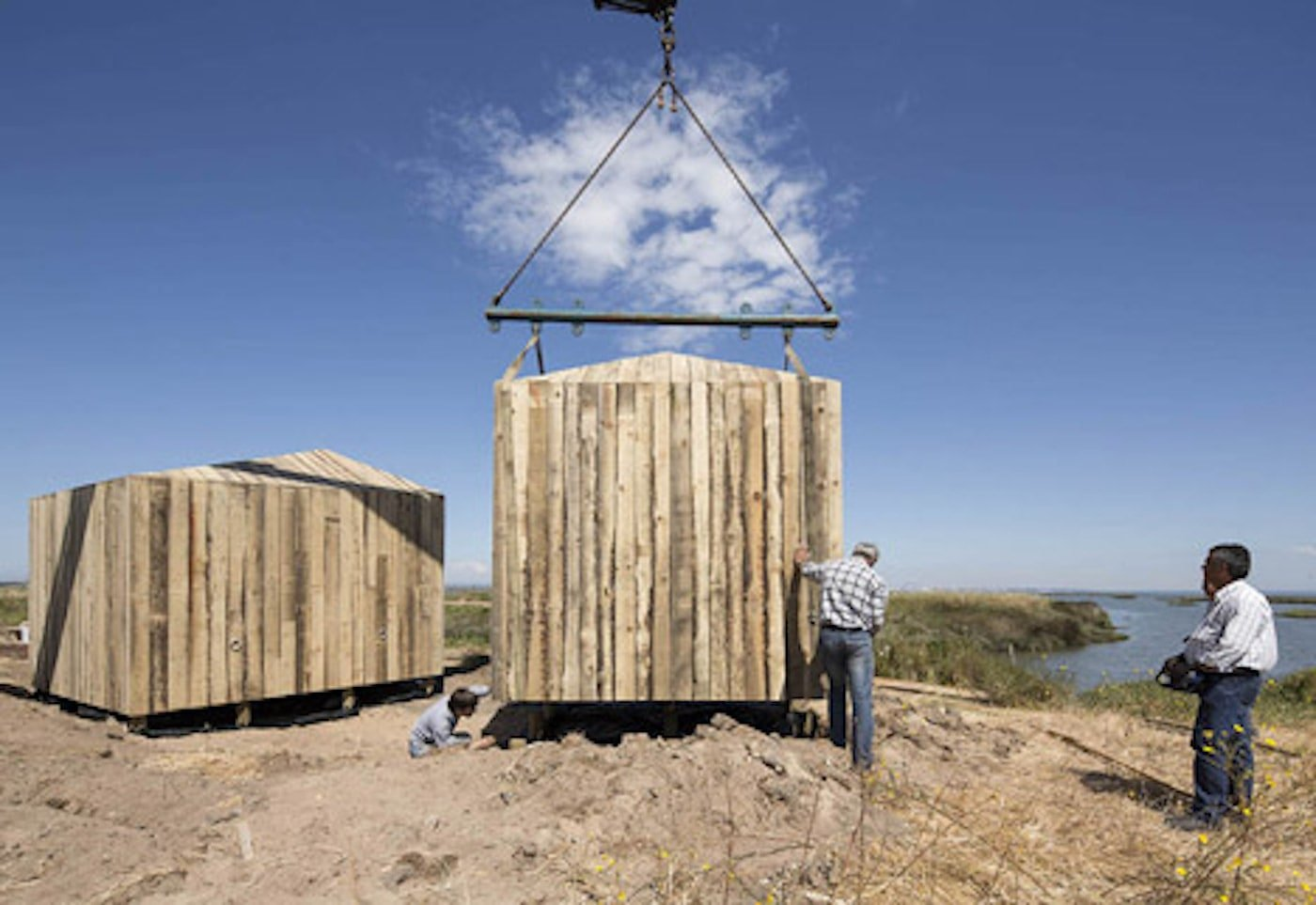 Recycled timber cabins craned onto site