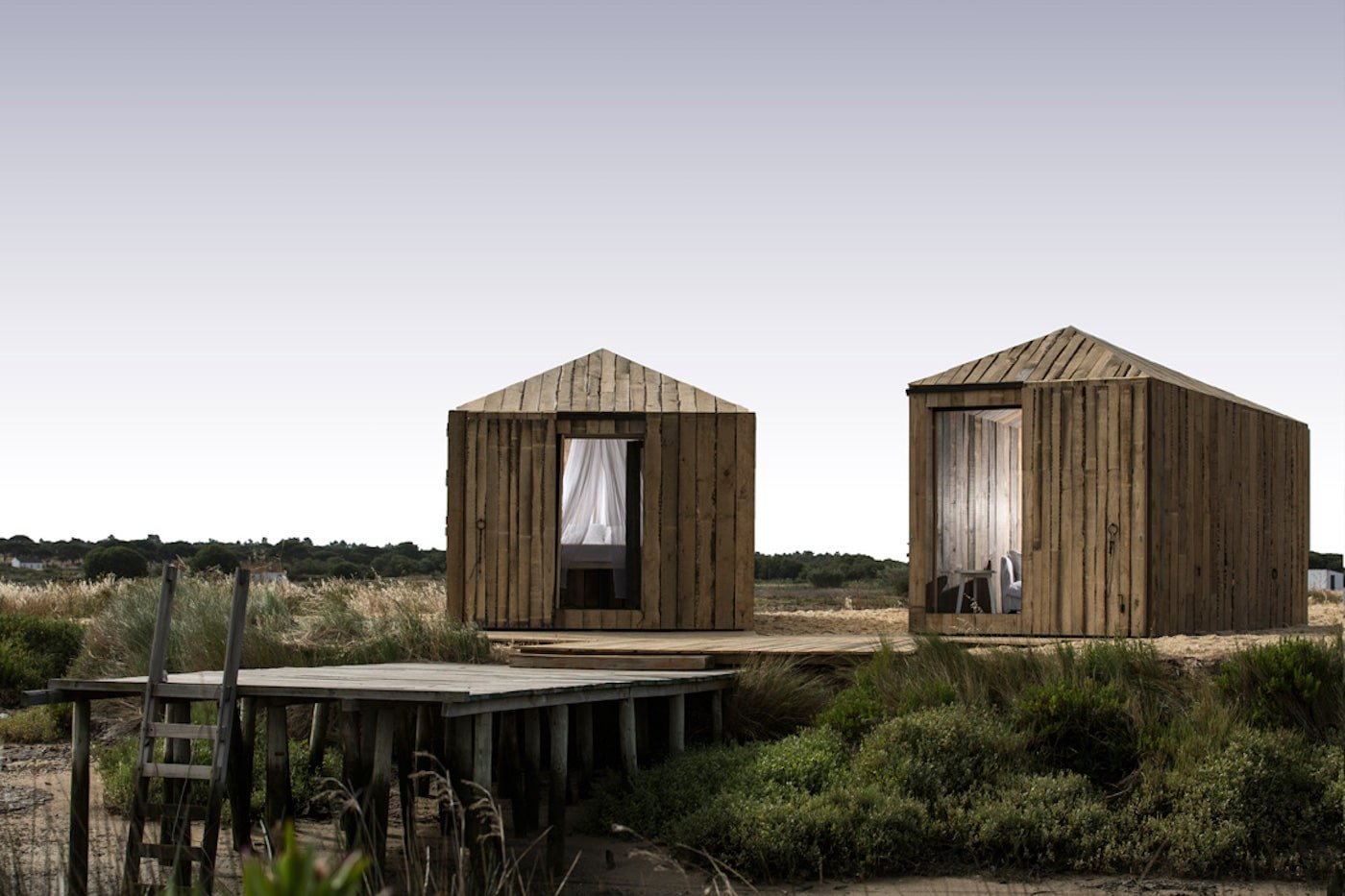 Timber huts next to river