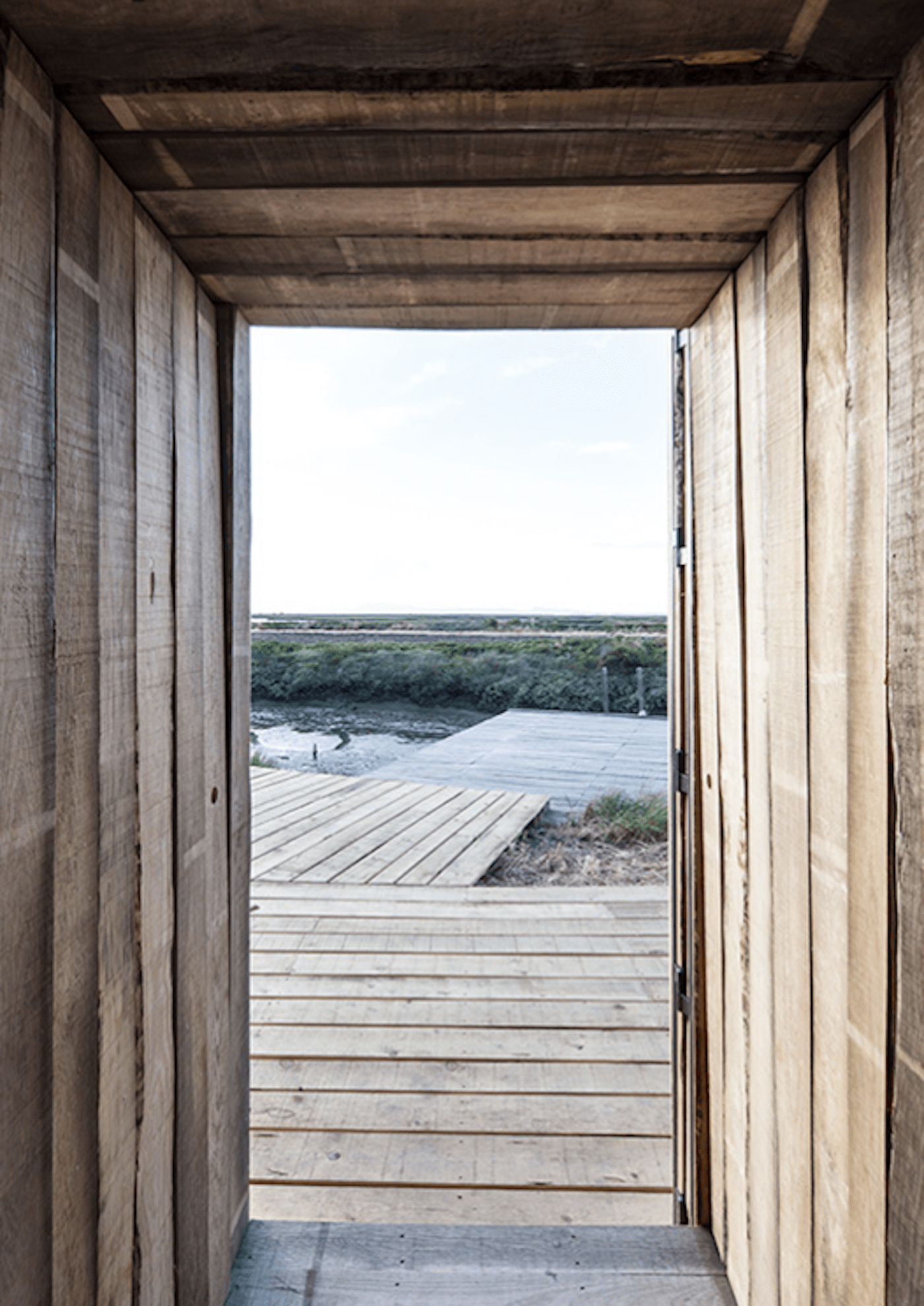 Views towards river from recycled timber hut