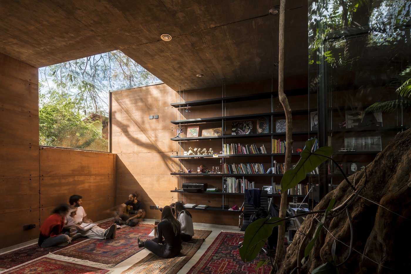Rammed earth building with timber bookcase and skylight