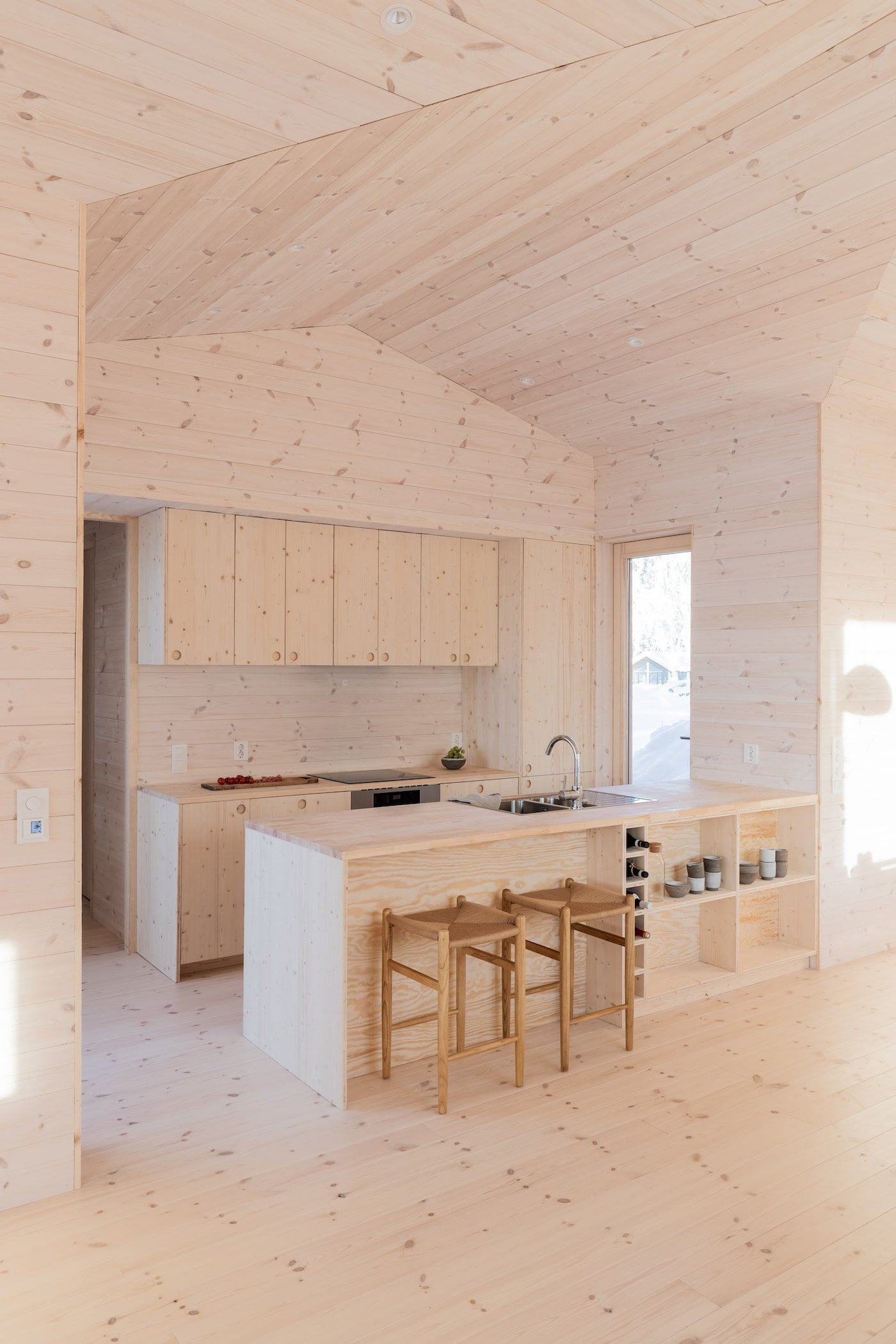 All timber kitchen with timber bench top in Kvitfjell Cabin