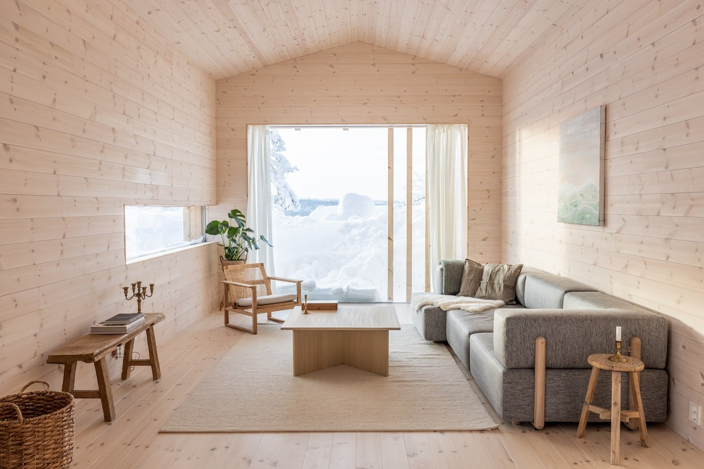Timber lined ceiling, walls and floor in lounge room of Kvitfjell Cabin