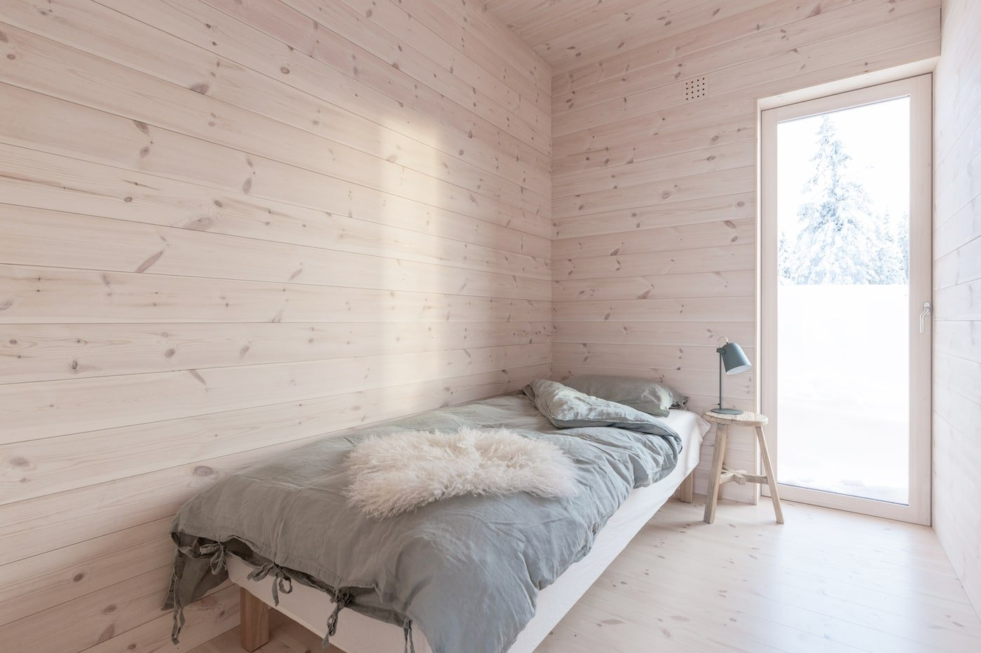 All timber bedroom with grey bedspread in all timber Kvitfjell Cabin