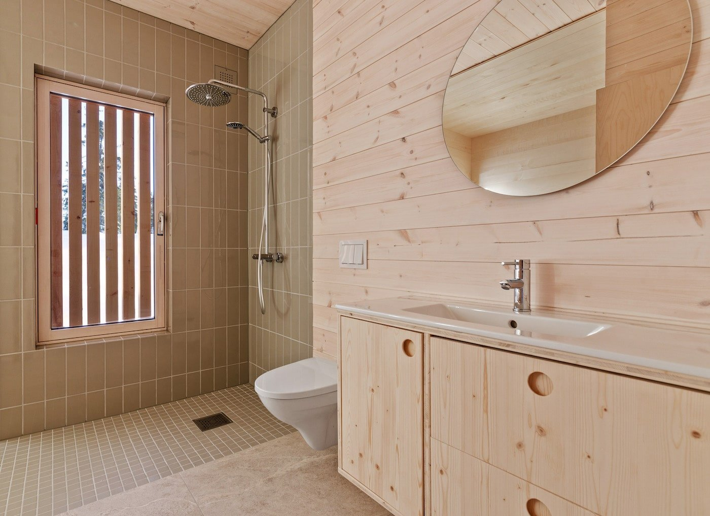 Timber bathroom with timber joinery in Kvitfjell Cabin