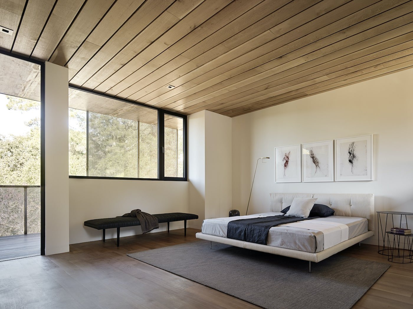 Master bedroom with timber lined ceiling in net-zero home