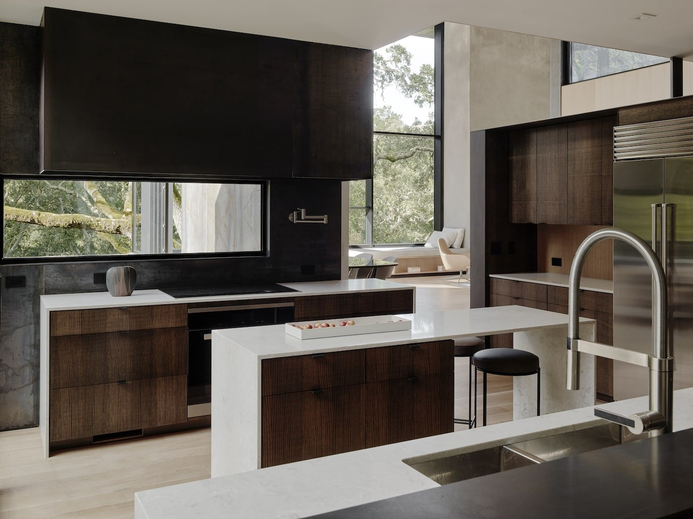 Kitchen with timber joinery and stone bench top in net-zero home