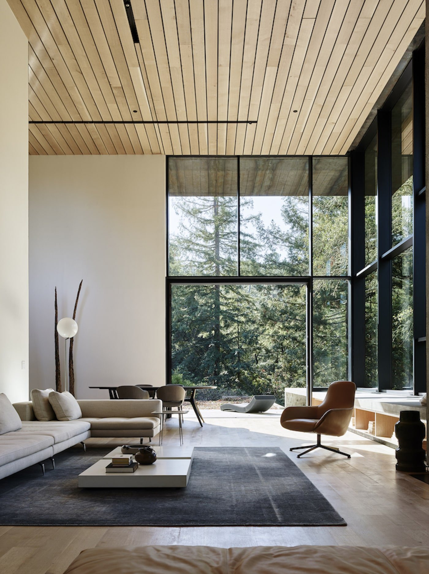 Lounge room with timber lined ceiling in net-zero house
