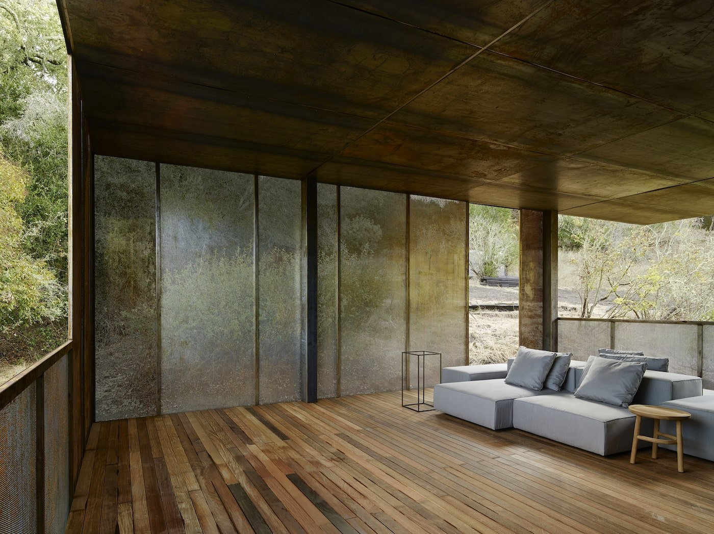 Sitting room with corten steel mesh and timber lined ceiling