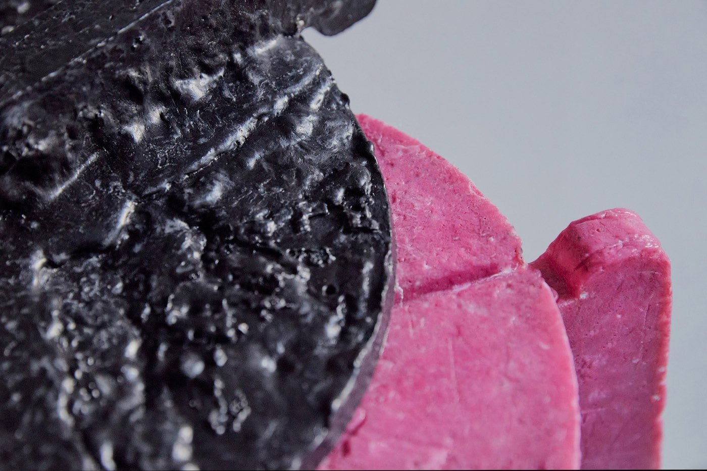 Close up of black and pink stools made from recycled face masks