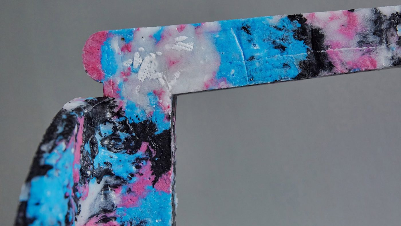 Close up view of stool leg made from recycled face masks