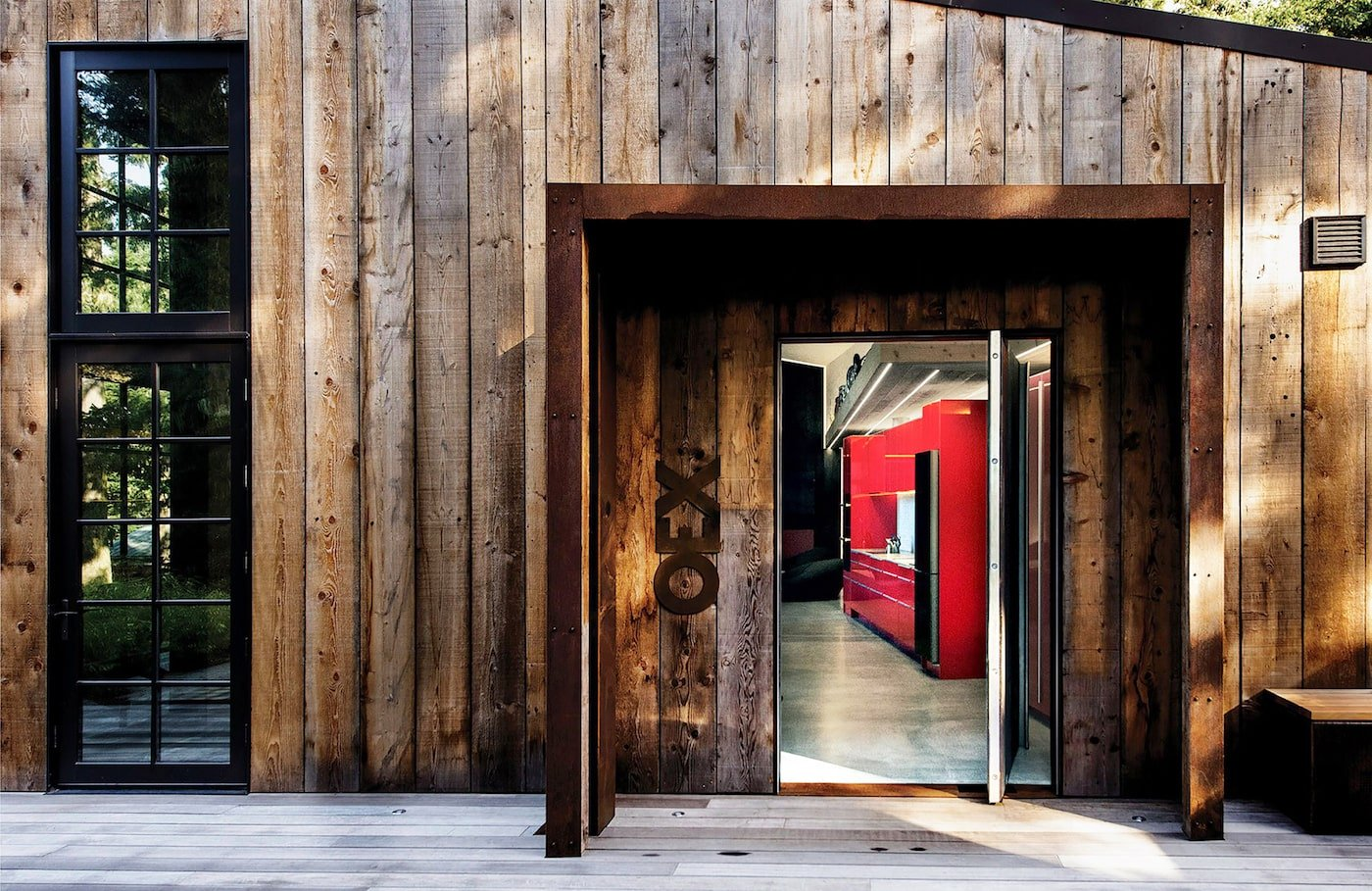 Red kitchen timber entry portal in sustainable retreat