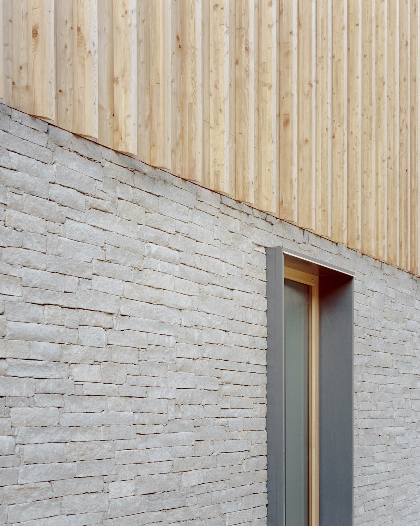 Locally sourced stone and sustainable timber facade