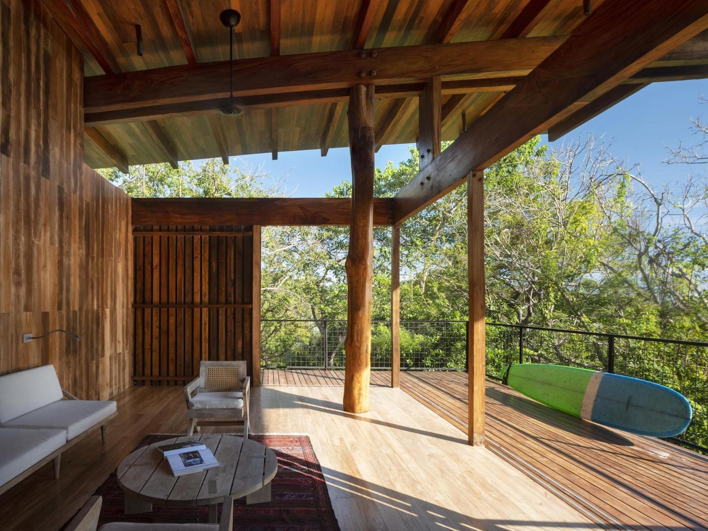 Timber operable screen open in loungeroom of timber home
