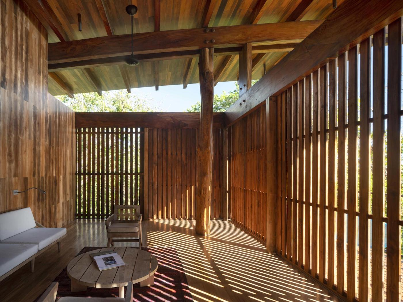 Timber operable screen closed in loungeroom of timber home