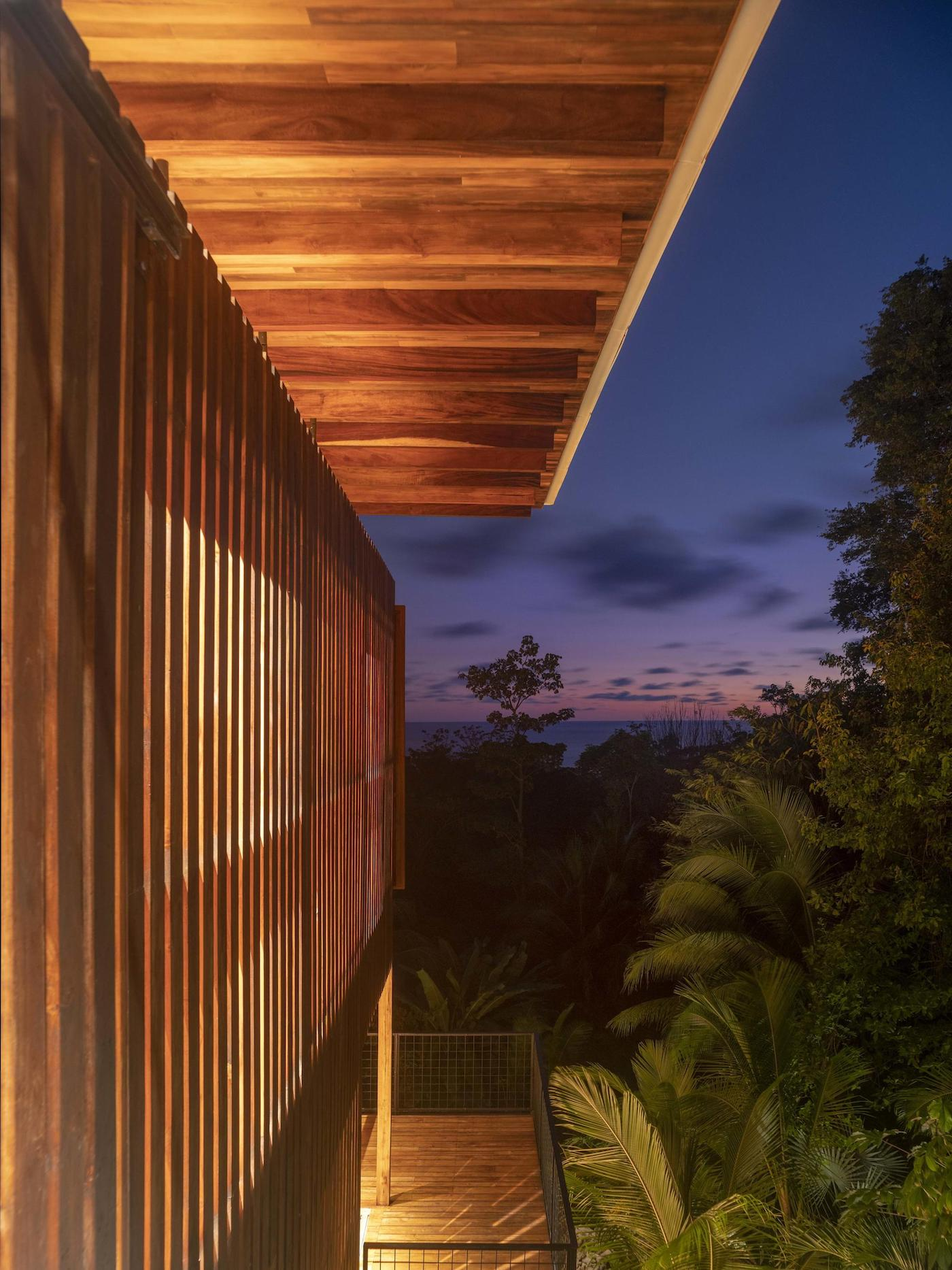 Night time exterior side view of timber battens